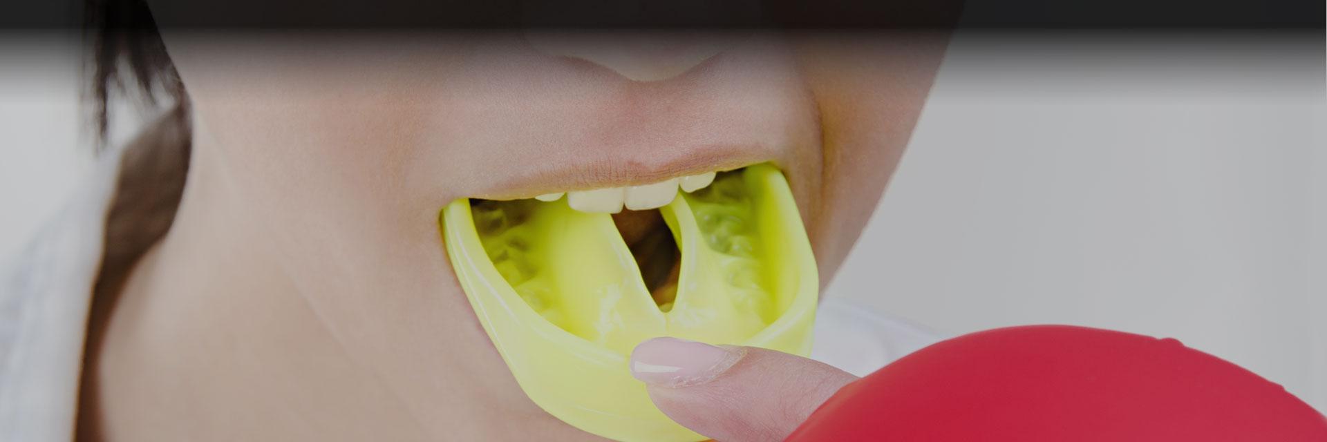Young boxing woman using mouthguard